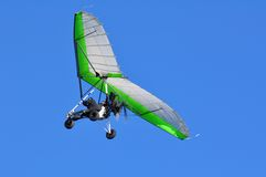 Ultralight. Motorized hangglider with green wing Stock Photo
