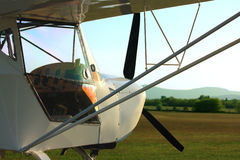 Ultralight aircraft in sunset Royalty Free Stock Images