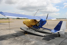 Ultralight airplane. Private ultralight airplane parked on a tarmac Royalty Free Stock Photos