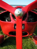 Ultralight airplane. Red ultralight airplane ready to fly in a sunny day Stock Image