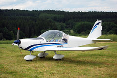 Ultralight airplane. Ultralight sport airplane on the ground before taking off Stock Photos