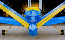 Ultralight airplane. Blue-yellow ultralight V-tail airplane Royalty Free Stock Photos
