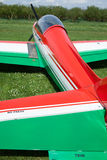 Ultralight Airplane Detail. Detail of a nice green/red ultralight airplane on a green field Royalty Free Stock Photography