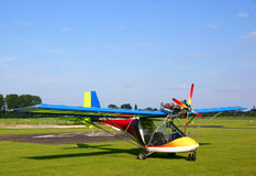 Ultralight plane. Small colorfull ultralight plane on a small airfield Stock Photo