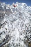 Ultralight plane flies over Pokhara and Annapurna region Stock Images