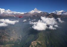 Ultralight plane flies over Pokhara and Annapurna region Stock Image