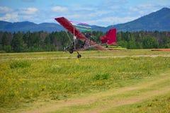 Ultralight plane flying low Stock Image