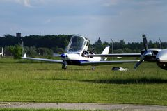 Ultralight airplane on the airfield. Ultralight private airplane are at the airfield Royalty Free Stock Image