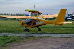 Ultralight airplane on the airfield. Ultralight private airplane are at the airfield Royalty Free Stock Photo