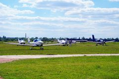 Ultralight airplanes on the airfield. Ultralight private airplanes are at the airfield Royalty Free Stock Photography
