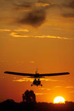 Ultralight silhouette 2. Two pilots fly in an ultralight plane Royalty Free Stock Photography