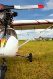 Ultralight weight plane on a grass field Royalty Free Stock Image