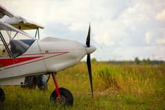 Ultralight weight plane on a grass field Royalty Free Stock Photos