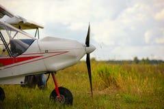 Ultralight weight plane on a grass field Royalty Free Stock Photos
