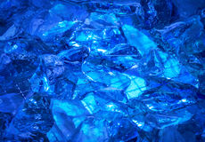 Ultramarine background of shiny-crystal stones lit mysterious gl Royalty Free Stock Image
