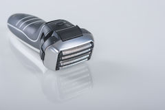 Ultramodern 5 Blades Electric Foil Arc Shaver. On Reflecting Surface. Horizontal Image Royalty Free Stock Photography
