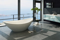 Ultramodern modern designbadruminre med havssikt Royaltyfri Foto