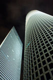 Ultramodern office buildings. A pair of ultramodern office buildings at night Royalty Free Stock Images