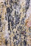 Ultranear Closeup of Conglomeration in Ochre. Ultranear shot of a stone found in the austrian alps, showing a conglomeration of dark and ochre colored minerals Stock Photography