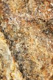 Closeup of reddish and ochre Mineral. Ultranear closeup of a piece of stone conglomeration of reddish and ochre minerals Royalty Free Stock Photos