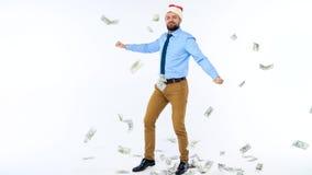 Ultrarapid av dollar som faller på formellt klädd man i den Santa Claus hatten arkivfilmer