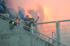 Ultras hooligans supporters burn flares during match Royalty Free Stock Photos