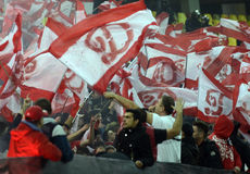 Ultras with red and white flags Royalty Free Stock Images