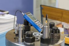 Ultrasonic bolt load measurement maintenance testing device for industrial work royalty free stock photography