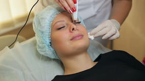 Ultrasonic cleaning of face in cosmetology salon. stock footage