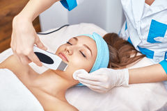 Ultrasonic face cleaning, peeling, in a beauty salon. ! Royalty Free Stock Image