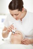 Ultrasonic facial cleaning at beauty treatment stock photos
