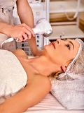 Ultrasonic facial treatment on ultrasound face machine. Woman receiving electric lift massage at spa salon. Electronic stimulation female muscles microcurrent stock photos