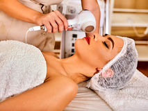Ultrasonic facial treatment on ultrasound face machine. Royalty Free Stock Photos