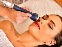 Ultrasonic facial treatment on ultrasound man face machine. Stock Photography