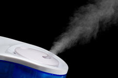 Ultrasonic Humidifier. An Ultrasonic Humidifier on a Black Background Stock Image