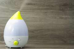 Ultrasonic humidifier. On the grey wooden background Stock Images