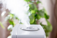 Ultrasonic humidifier in the house. Humidification. Vapor. Ultrasonic humidifier in the house. Humidification Royalty Free Stock Photos