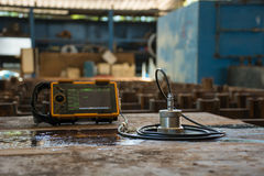 Ultrasonic test to detect imperfection or defect of steel plate. In Workshop, NDT Inspection royalty free stock photo
