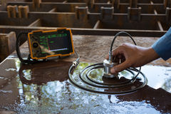 Ultrasonic test to detect imperfection or defect of steel plate. In Workshop, NDT Inspection Stock Photos