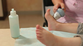 Ultrasonic treatment of the legs of a small child. Ultrasound treatment for feet the small kid in the physiotherapy room stock footage