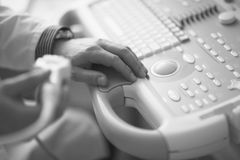 Ultrasonography. The doctor conducts ultrasonographic examination of the patient Stock Images
