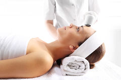 Ultrasound beauty treatment. The woman's face during a facial at a beauty salon Stock Photo
