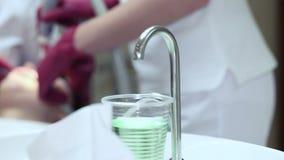Ultrasound bleaching a patient's teeth stock video