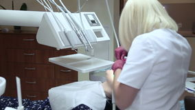 Ultrasound bleaching a patient's teeth stock footage