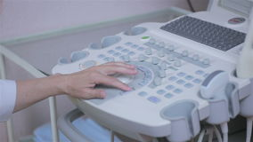 Ultrasound device keyboard, hands of unrecognizable doctor workimg with ultrasonic equipment. stock video