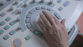 Ultrasound device keyboard, hands of unrecognizable doctor workimg with ultrasonic equipment. HD stock video footage