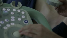 Ultrasound diagnostic machine. Medical specialist analysing woman abdomen using ultrasound machine stock footage