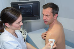 Ultrasound echo on shoulder man Royalty Free Stock Photo