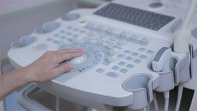 Ultrasound edevice keyboard closeup, hands of doctor clicks on the button. HD. Doctor hands is operating U S test unit and examines patient with ultrasonic stock video footage