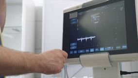 Ultrasound examination devices monitor close-up, color human organs. Medical tools in hospital or clinic.  stock video footage